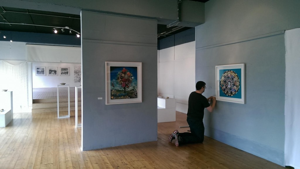 Gavin preparing for the exhibition during Clifden Arts week 2014
